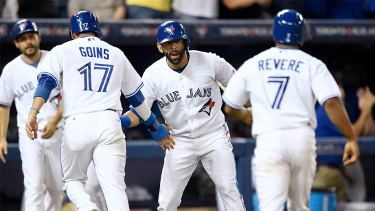 Toronto Blue Jays' Jose Bautista, center, congratulates teammates Ryan Goins, (17) and Ben Revere (7) after scoring on the Josh Donaldson's two-run triple during the fifth inning of a baseball game against the Toronto Blue Jays, Monday, Aug. 31, 2015 in Toronto. (Frank Gunn/The Canadian Press via AP) MANDATORY CREDIT
